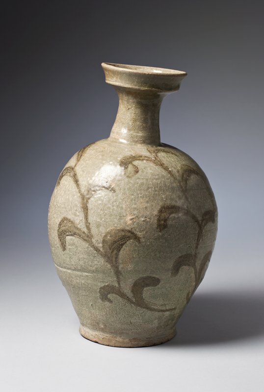jar with narrow base, wider body and shoulder, long, narrow neck, and widely flared, stepped mouth; gray-green glaze with vertical vines with leaves