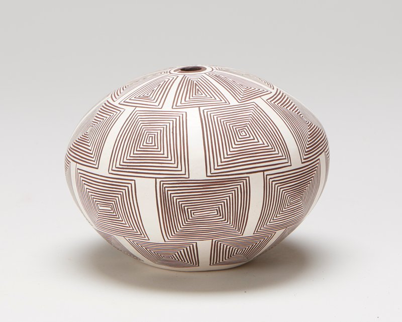 white ground with four rows of squared swirls in tight linear maze pattern; wide, round shape with no neck and small mouth
