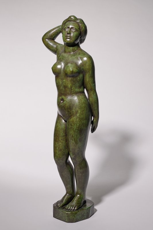 standing nude female with PR knee slightly bent; PR hand on back of head; PL hand behind body; hair pulled back in a low roll around back of head; dark patina with green