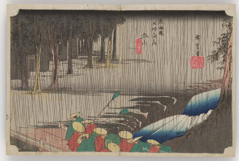 rainy scene; group of figures in red and green cloaks and round hats stand on a dock, some holding green pompoms on sticks; edge of a forest in background