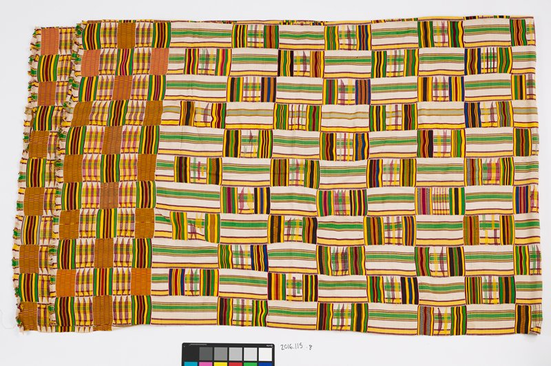 large panel with green, yellow, maroon and blue linear designs alternating directions; two ends of panel are fringed