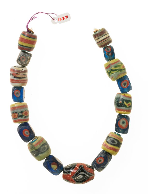 Necklace, glass beads, Egyptian, I-V Century A.D. no dims on cat. card; NUMERICAL CAT. CARD MISSING; unnumbered. String of 17 thick cylindrical beads; glass.