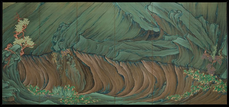 right; close-up view of a dramatic landscape formed by a lava flow; sweeping lines, jagged cliffs in greens and browns; leafy foliage along lower R; shrubs with small blue and gold leaves LR; gnarled tree at L near more leafy foliage, ferns, and another blue and gold plant