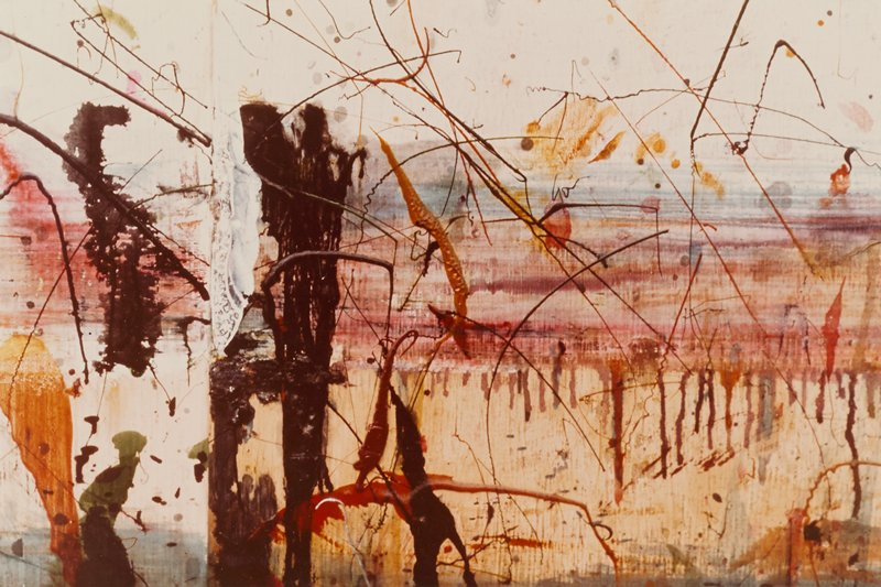 color image of a wall section with colorful painting: horizontal, brushed bands of color with dripping pigment; splattered crisscrossing lines; black and red blotches of wash; mounted to white mat