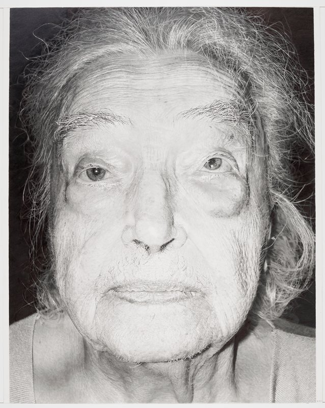 extremely detailed close-up of an elderly woman's face