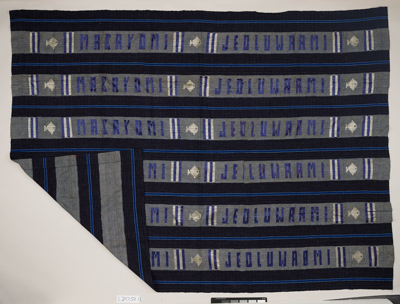 "woven strips sewn together; dark blue with white and bright blue stripes alternate with strips woven with dark blue and white stripes and stitched with white fish and blue and white vertical stripes in silk along with ""MABAYOMI JEOLUWAAMI"" (maker's name?) in blue"