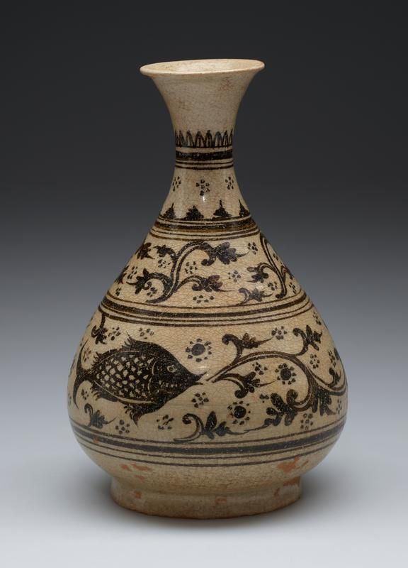 small beige colored vase with bulbous body, narrow neck, flared mouth; dark designs of fish and organic vine motif separated by horizontal bands; tendril design and geometric design up to neck