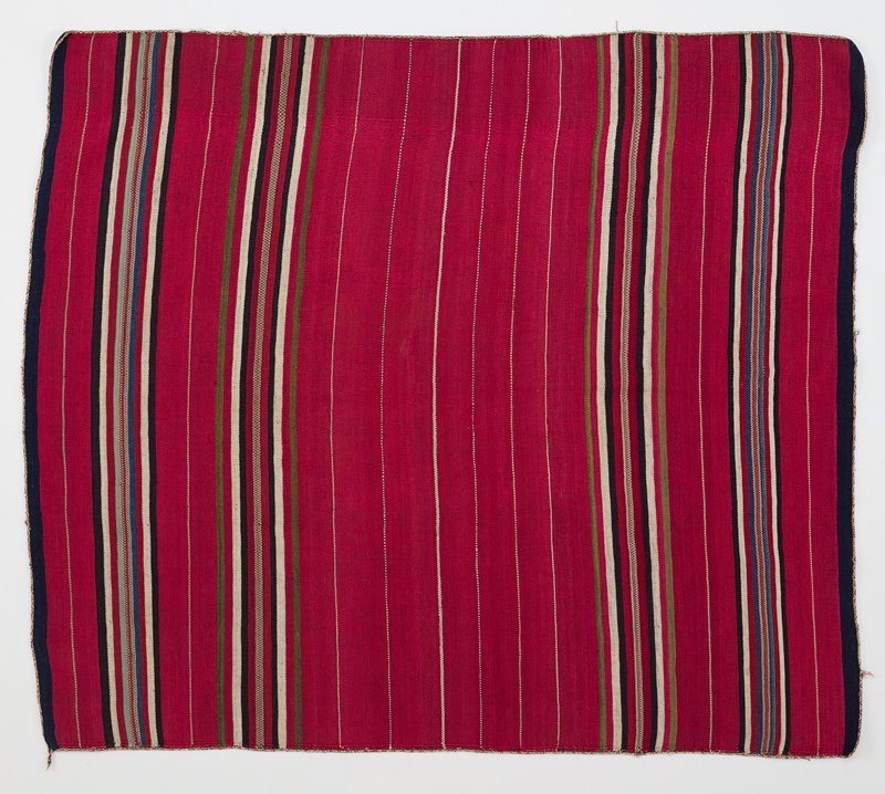 red textile with white pinstripe; two wider bands of black, white, green, red, blue, teal stripes along short ends