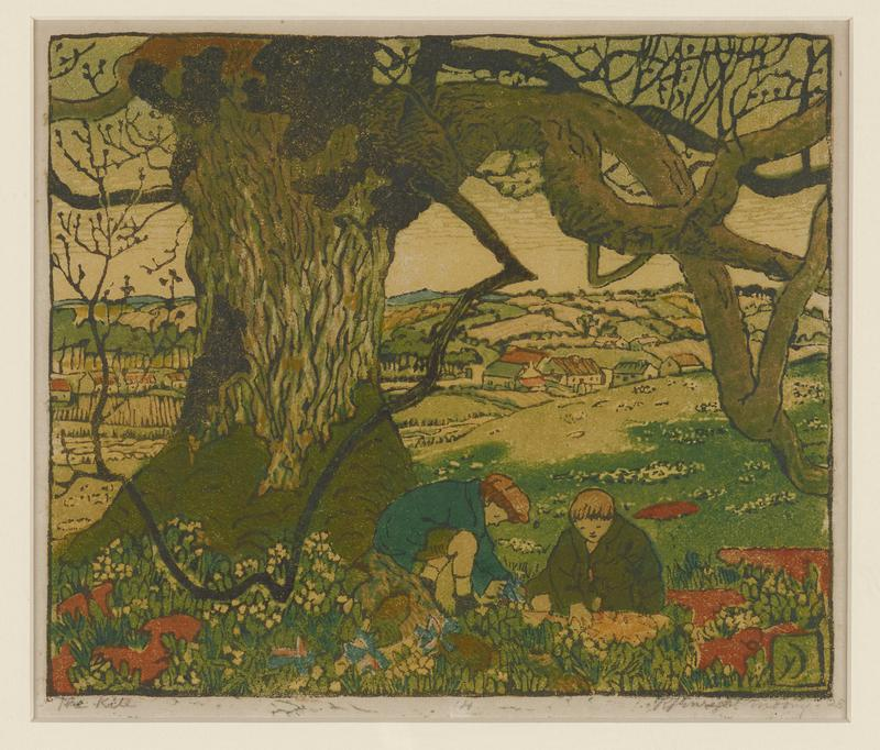 richly colored print of two young boys working on a kite in the grass and flowers below a large tree; farmland, tree groves, and small village in background