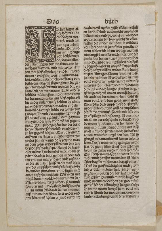 printed text page--front and back--with two columns on each side of page; large decorative initial with scroll motif in ULC