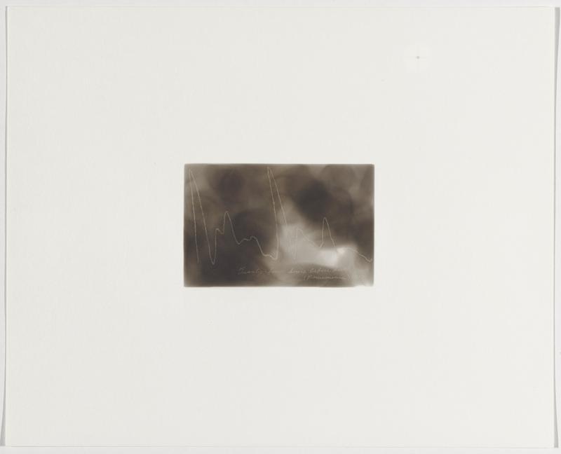 smokey grey background; zigzagging white line with very tall, irregular peaks