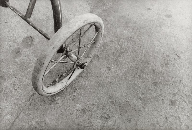 back wheel of old tricycle