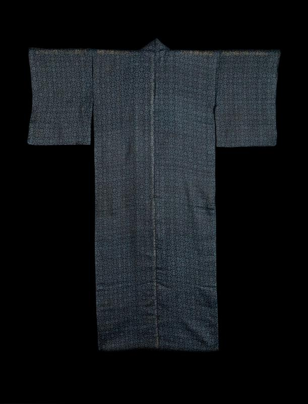 dark blue robe with lighter blue pattern; alternating stepped diamonds and squares throughout; white fabric reinforcment attached to interior back center seam