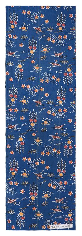 rectangular fragment of blue fabric with pattern; red, yellow, purple, and white flowers, white leaves and accents, and purple cranes throughout