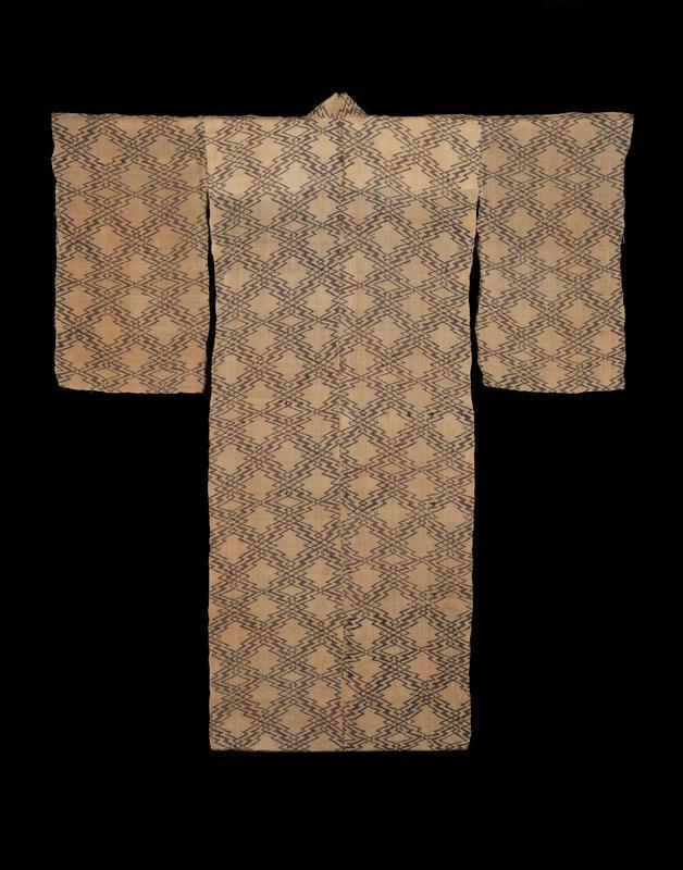 light brown robe with black zigzag diamond pattern; white interior lining across upper back