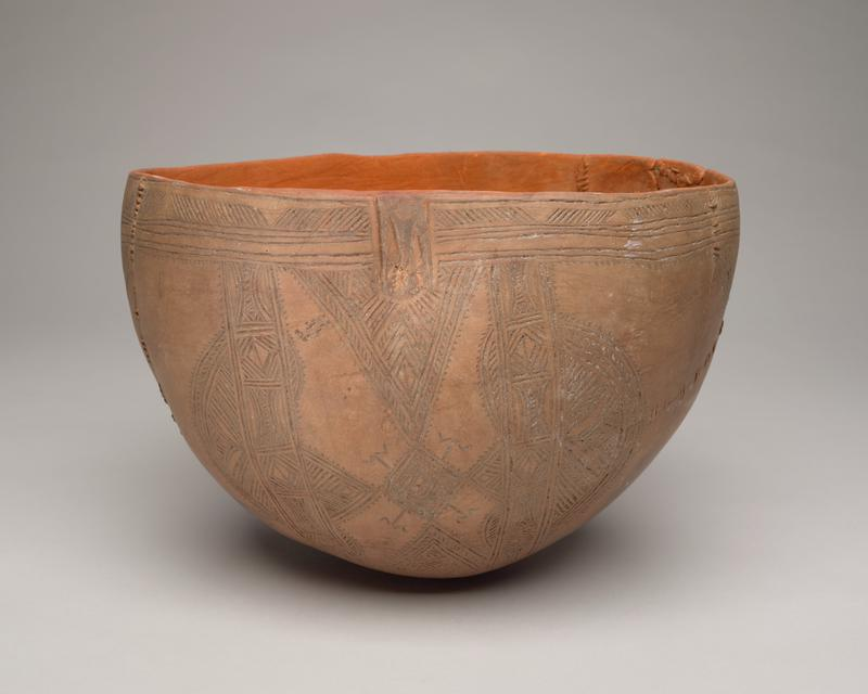 bowl with rounded bottom made from a gourd; orange interior, tan exterior; exterior decorated with incised half-circles, diamonds, triangles, and flower motifs