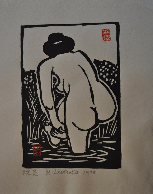 nude female figure with back to viewer standing in small body of water washing her feet; reeds at the shore