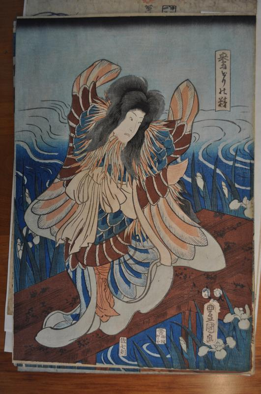 triptych, with three sheets combining to make a single image; figures on left, center and right; left figure is standing, with large wings on right and let; fringed neckline in pale blue and peach; white flowing sleeves, with under robe with blue, scaly pattern; rippling waves behind figure, who stands on a dock; flowers and long, thin leaves surround dock; center figure has outspread wings in peach and blue pigments; fringed neck piece in g pale blue and peach shades, and sits cross legged on a dock; water in background, with flowers and thin leaves jutting up around dock; tree branch in URC of image that extends into right sheet; right figure stands on land, wearing colorful intricate robes and armor, holding a raised sword in hands; bare outspread feet; tree on right that extends into URC