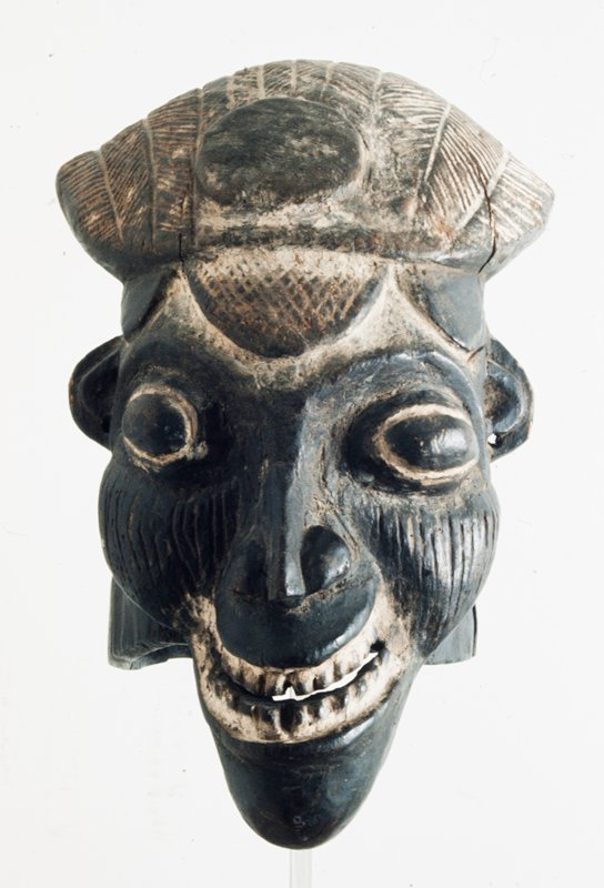 dance mask possibly Manjong Warrior Society. Helmet type with protruding eyes and high Rameses headdress.