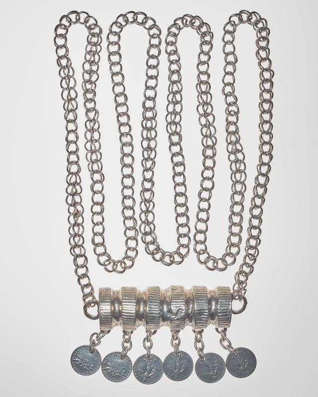 hollow, cylindrical ornament attached at sides to looped chain; six French 50 centimes coins hanging from ornament on linked chains; all coins have a figure surrounded by text on one side and a branch of leaves with text on the other