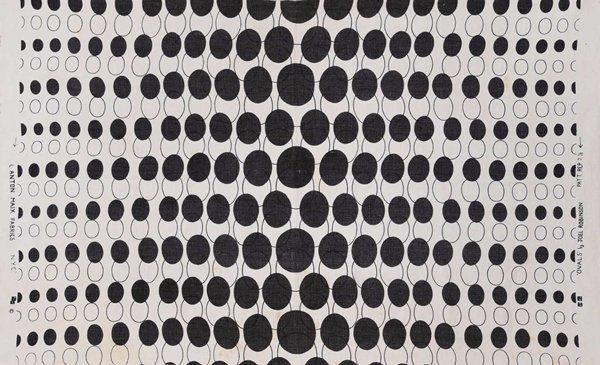 white panel printed with a design of black ovals of various sizes and outlines of ovals of various sizes; stitched on long sides