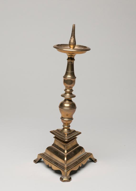 small pricket, baluster turned stem and finely molded triangular base with champhered feet