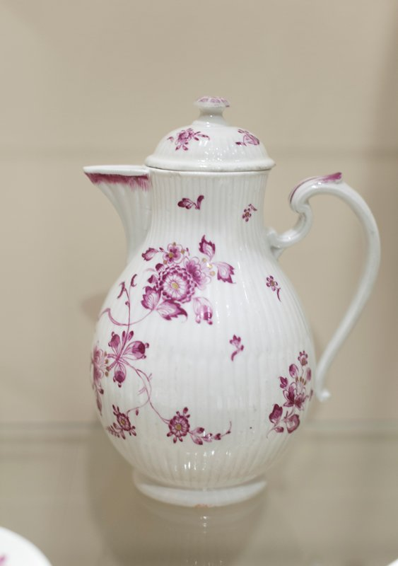 Coffee Pot with cover, ceramic, ribbed with floral decoration in carmine and gold. Cover from smaller vessel of same design, German XVIIIc cat. dims 7-1/2 x 5-1/2'
