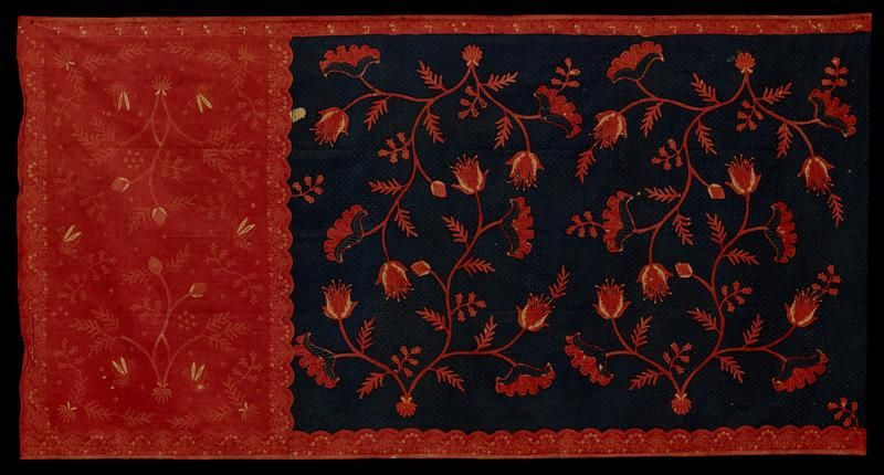 Sarong Panel, dark blue dotted ground with central floral motive and border of orange.