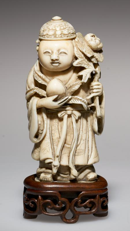 carved figure, with cap as the stopper; carrying a peach in one hand, the peony in the other; garments etched