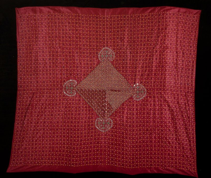 Pulchari, woman's veil, of red stain finely embroidered with punch work design over entire surface; rectangular motive in center of embroidered design with mirror discs.