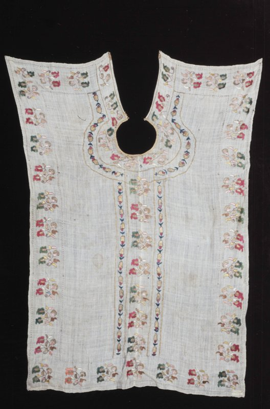 Barber's Apron, flat piece of linen slit down back with hole for head; elaborately embroidered in colors.