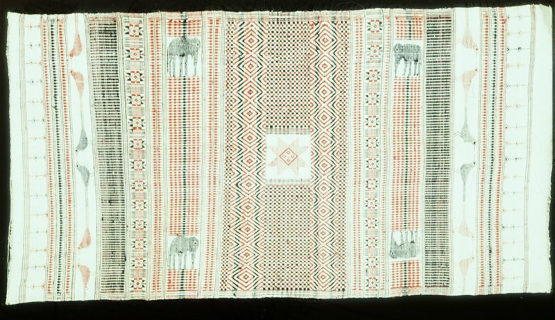 Sarong, white with red and black stripe decoration and elephant and bird motives. Cotton.