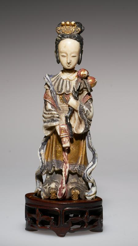 carved figure, holding the peach, emblem of longevity and also of marriage