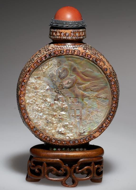 Snuff bottle; lacquer; red coral top with silver setting; sides inlaid with Mother of Pearl; natural piece of Abalone Shell set in panels on each side. One panel partly carved.