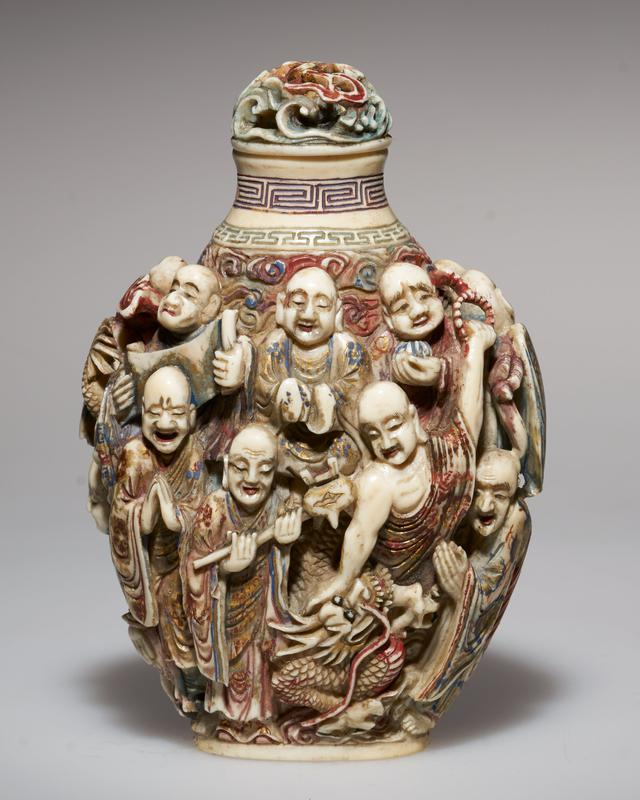 carved ivory with 'Rakan' disciples of Buddha in high relief; painted; carved stopper and ivory spoon