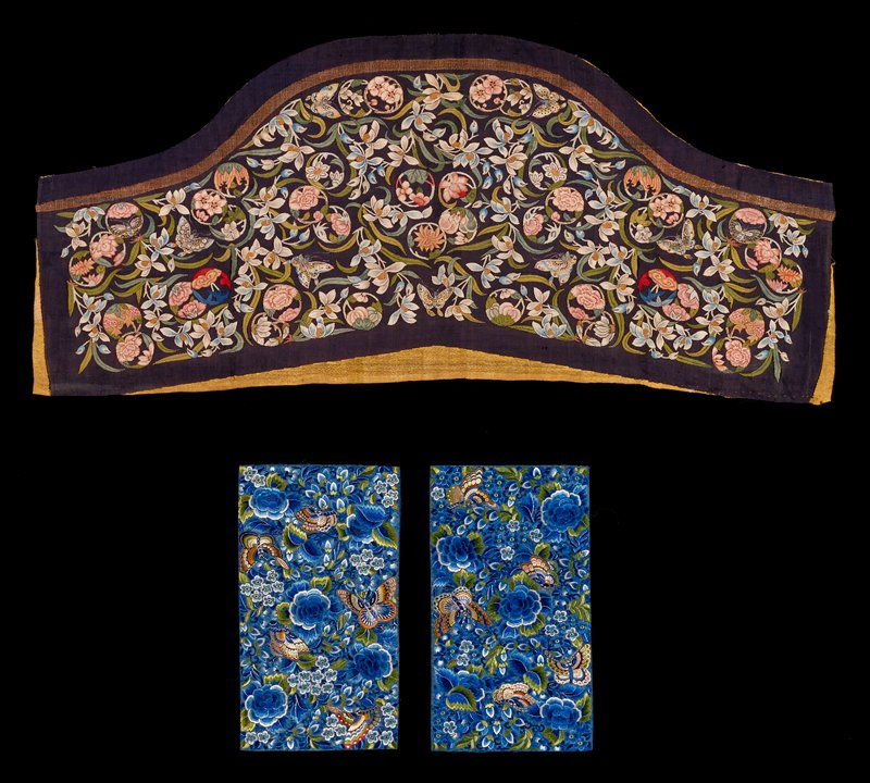 Small embroidered panel of blue silk damask closely worked with roses, leaves and butterflies, in colored silks, chiefly shades of bule and green.
