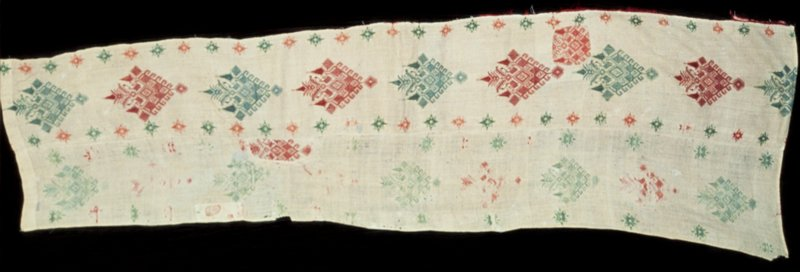 "Part of bed tent embroidered with red and green silk in darning stitch. The ""Queen Pattern"" in single units are set vertically one above the other. Alternating group of islands known as the Southern Sporades. Probably from the island of Cos. Wider at the bottom than at the top."