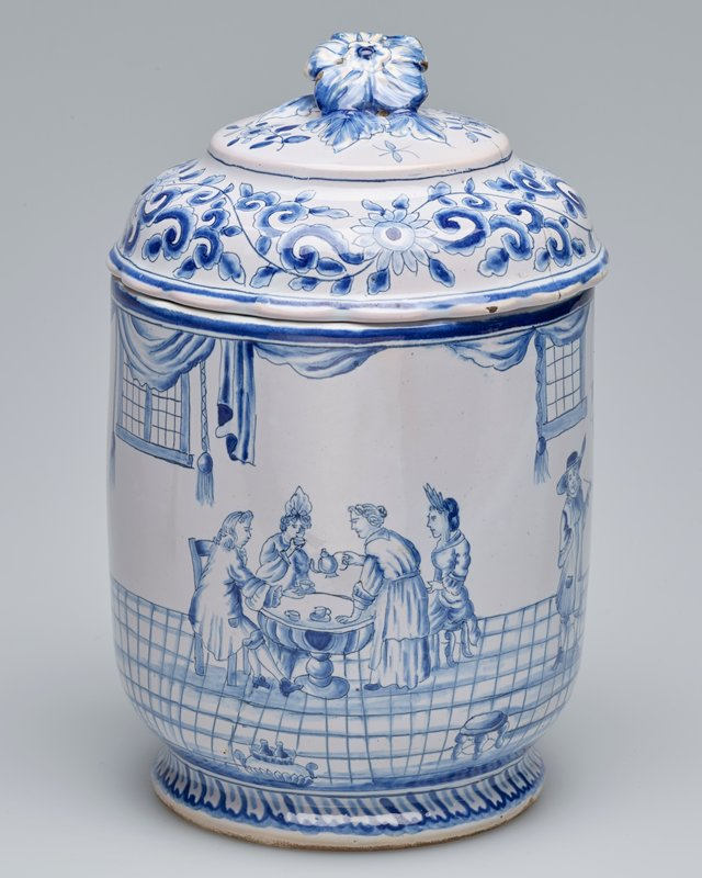 Jar and lid, ceramic, Dutch, XVIII c. cat. card dims 7-1/4 x 4-1/2' One of a pair of covered jars. Figures of scenes and interiors painted in blue.