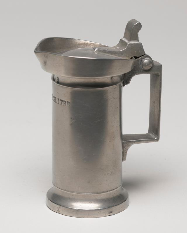wine measure with square handle and attached round lid which falls inside the lip,