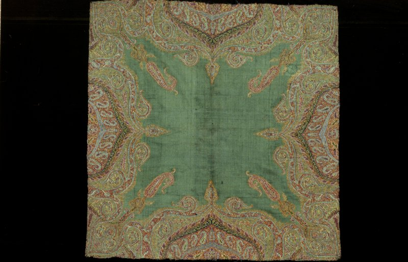 shawl piece, probably central portion of Kussaba; green ground with butha or cones and arabesques; the corner ornaments are elaborated butha