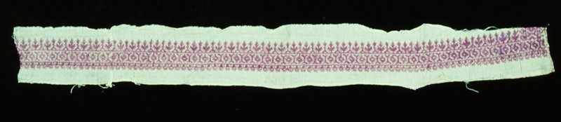 pillow border, embroidered in lavendar silk in diagonal and straight stitch in a conventionalized design of flowers and trees; edge is finished in buttonhole stitch