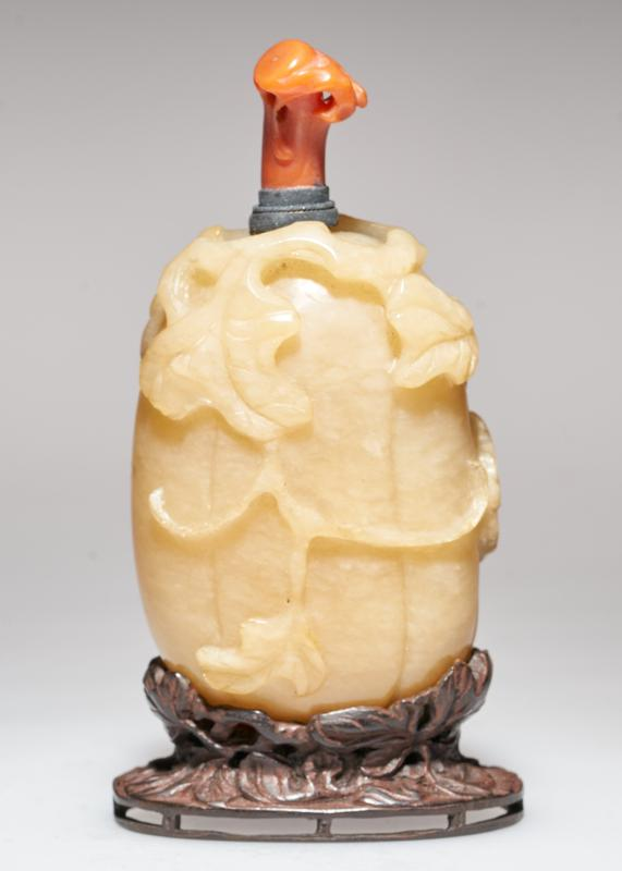 carved yellow jade with coral stopper; carved teakwood stand