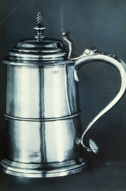 tankard, cylindrical body, spiral finial, scrolled thumb piece; plain handle tip; reeding at base.