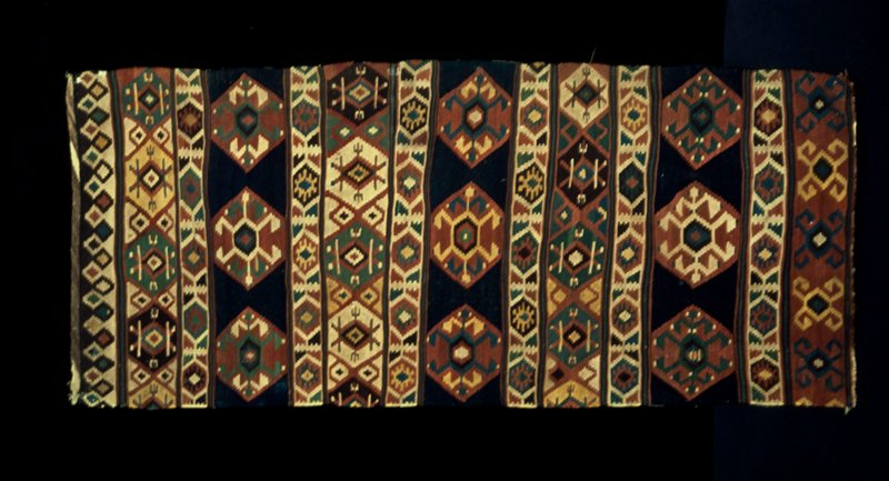 Rug, large, Shirvan Khilim. Three broad stripes of blue with hexagonal motives alternating with broad triple band in green, red and dark brown. This khilim has large openwork spaces. Wool