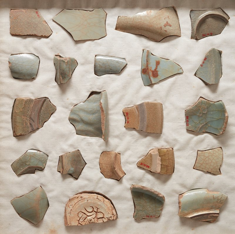 Fragment of plate. Pale clay body covered with thick crackled glaze of yellowish green. Broad, unglazed rim of foot on under side. One of 22 fragments of Kuan (Imperial) ware found at Black Turtle Hill. See card 36.10.1