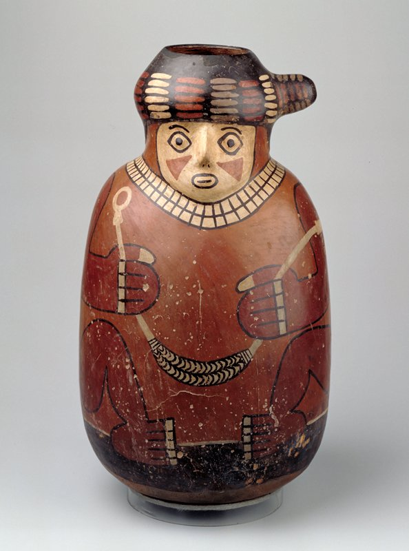 Large ovoid jar representing a crouching human figure whose head forms neck of vase. All details except nose and turban headdress painted in polychrome on polished red ground. Rounded bottom, stand.