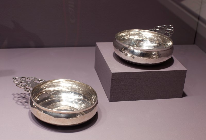 porringer, one of a pair, with shallow bowls slightly domed in center and handles pierced in keyhole design; handles bear the inititals [A*O]