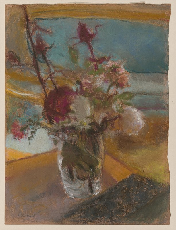 Vase of flowers on a table with sofa in the background