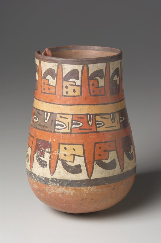 vase with three bands of faces depicting the different races; polychromed pottery in browns, yellow and gray
