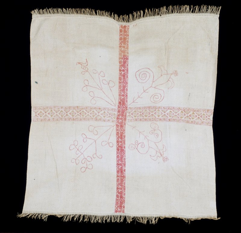 small tablecloth, fitted with two central panels, one embroidered with red horses the other in a pink and brown geometric motif, on fine linen ground woven in diamond pattern